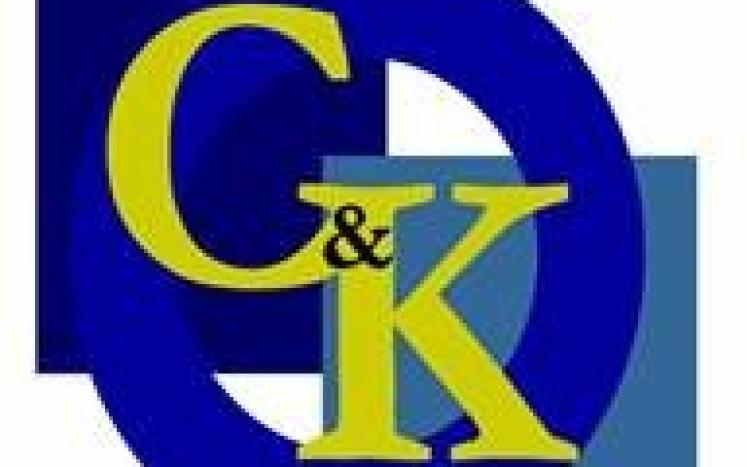 Chalmers and Kubeck South Blue and Gold Lettering Logo